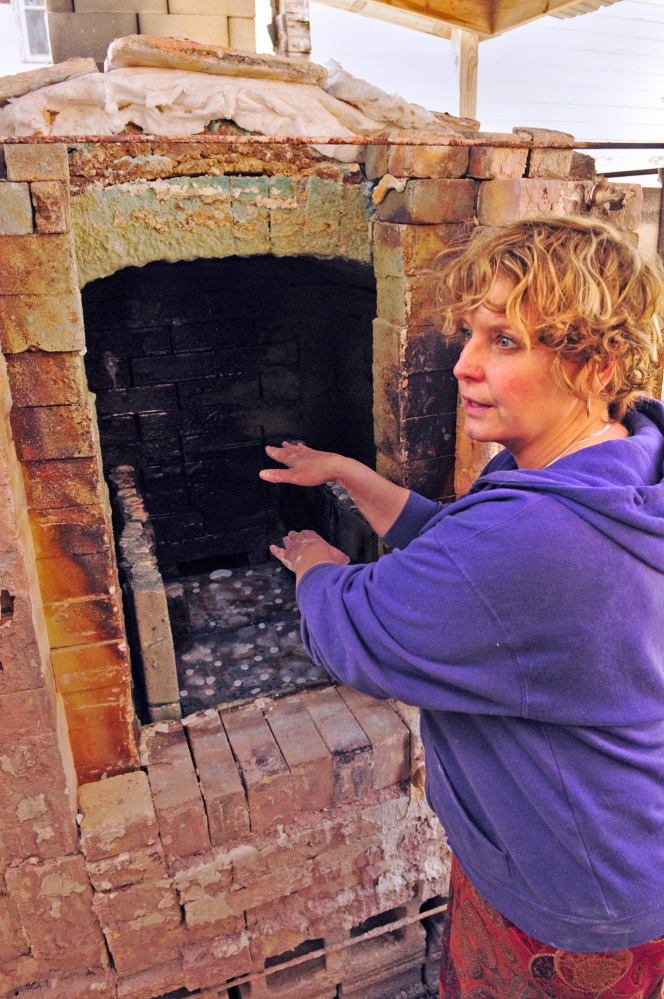 Dry heat: Lori Keenan Watts talks about her kiln during a tour of her Fine Mess Pottery during the Maine Pottery Tour on Saturday in Augusta.