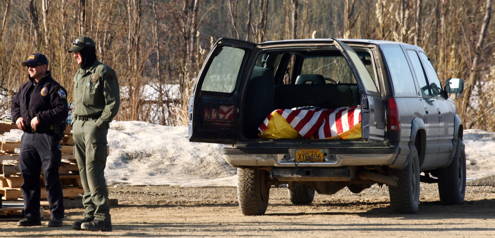 """The bodies of Alaska State Trooper Sergeant Patrick """"Scott"""" Johnson and Trooper Gabriel """"Gabe"""" Rich await transport to Anchorage, Alaska on Friday, at the airport in the village of Tanana, Alaska."""