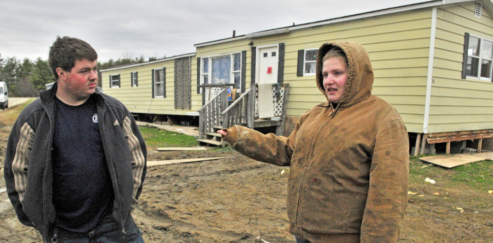 Park problems: John Tuttle, left, and Harley Clifford talk about the problems they've had with water being shut off at Meadowbrook Trailer Park last month.