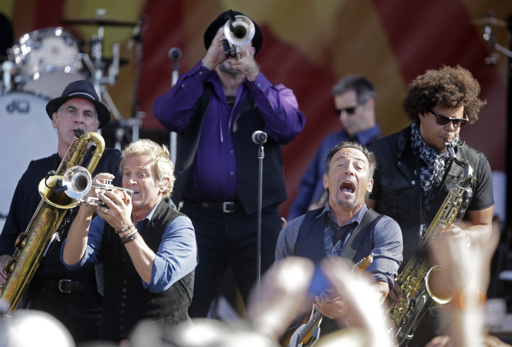 Bruce Springsteen, front right, performs with the E Street Band at the New Orleans Jazz and Heritage Festival in New Orleans, Saturday.