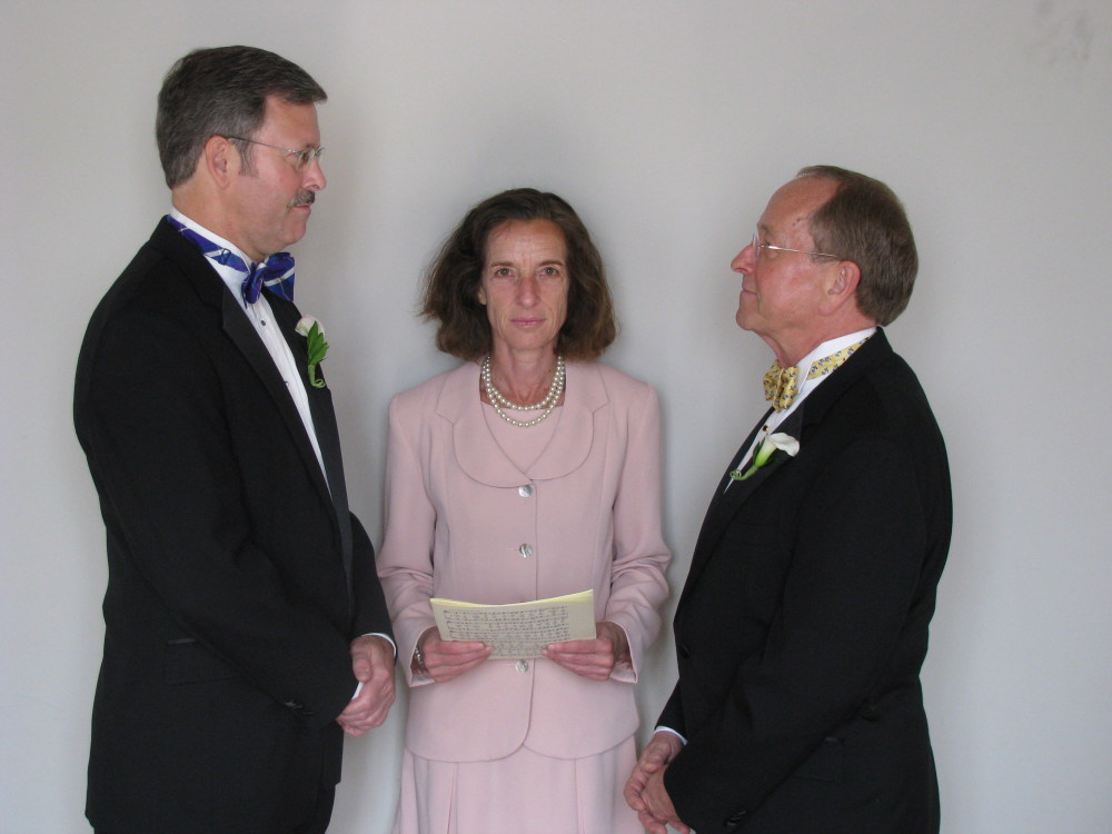 Mark Andrew, left, and Bishop V. Gene Robinson during their private civil union ceremony performed by Ronna Wise in Concord, N.H.