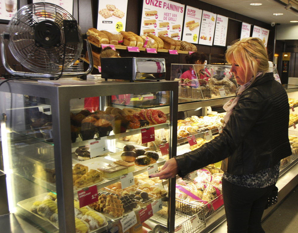 Dunkin' Donuts is testing whether the American doughnut can compete with some of the world's most famous sweet snacks in their own homelands. Pastries on display at this Bakker Bart store in Amsterdam include: Bossche bollen, appeltaart, tompouces, soesjes, Luikse wafels, and puddingbroodjes. They also sell a doughnut.