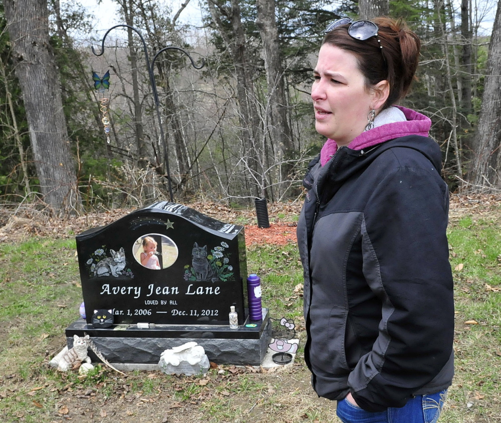 HEARTBREAKING: Tabitha Souzer, Avery Lane's mother, speaks at her daughter's gravesite at the Friend's Cemetery in Fairfield on Tuesday. Souzer said the gravesite has been vandalized three times, most recently over the weekend.