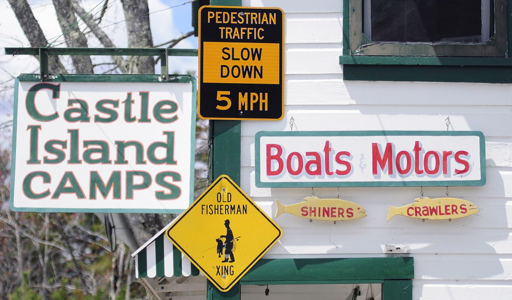 """NEW LOCATION: The """"Pedestrian Traffic Slow Down 5 MPH"""" sign that had been on a post near Castle Island Camps is now hanging on the building in Belgrade."""