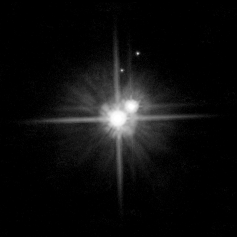 Reclassified but not forgotten: Dwarf-planet system Pluto-Charon, with tiny moons Hydra and Nix.
