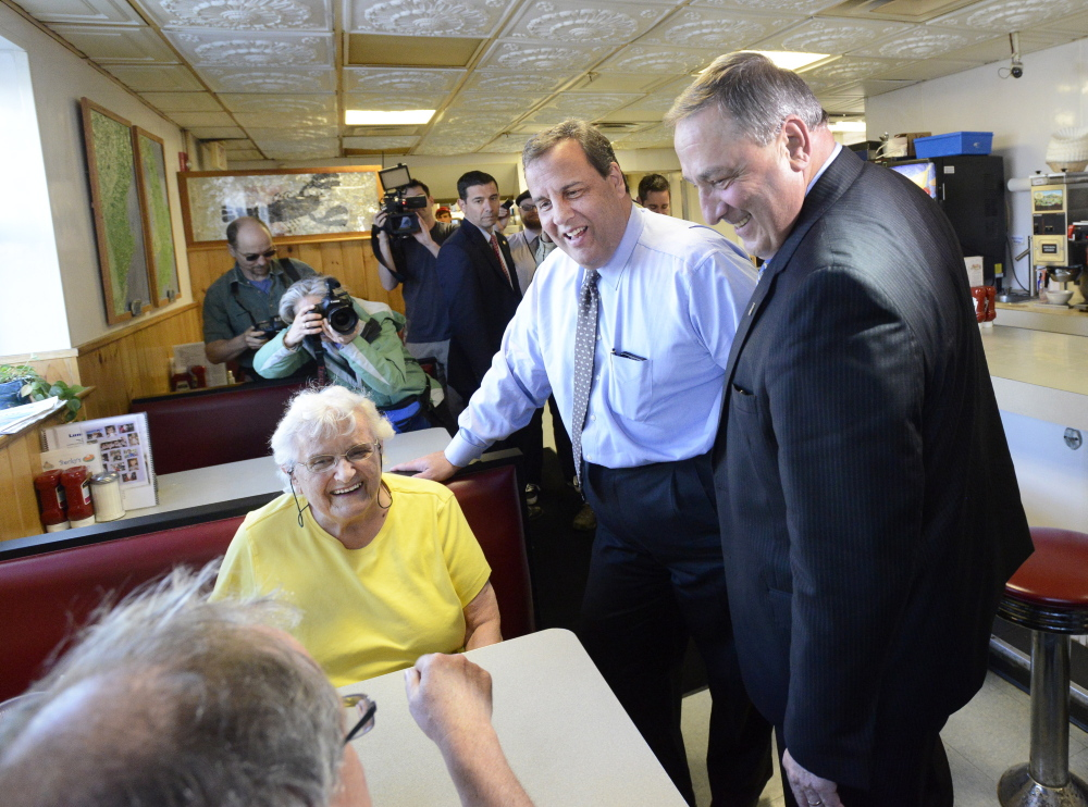 New Jersey Gov. Chris Christie and Maine Gov. Paul LePage talk with Gertrude Byard and her son Rich Byard of Portland during a stop Wednesday at Becky's Diner in Portland. The Republicans then attended a fundraiser at the nearby Holiday Inn by the Bay.