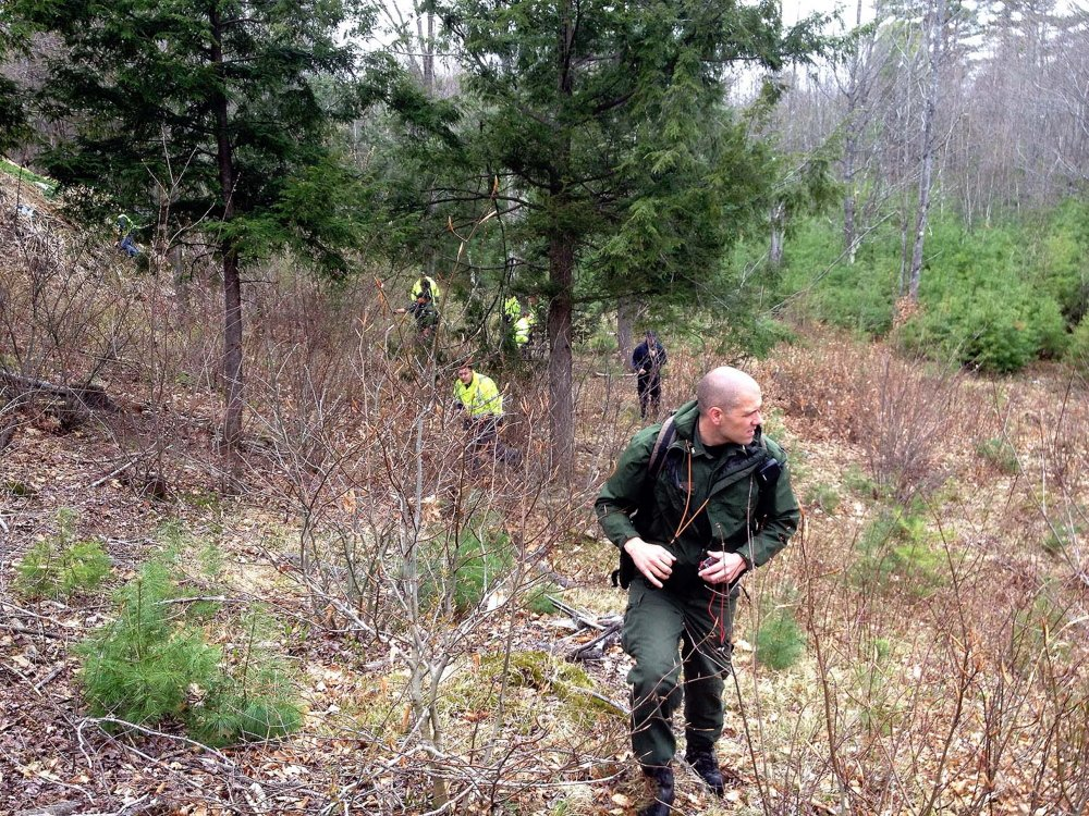 Led by Maine Game Warden Troy Thibodeau, EMTs, firefighters, game wardens and volunteers search for Jaden Dremsa along Route 5 in North Waterboro on Friday.