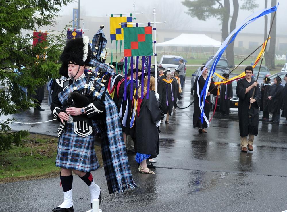 Bagpiper Robert Gillis leads the graduates to the Saint Joseph's College graduation ceremony in Standish.