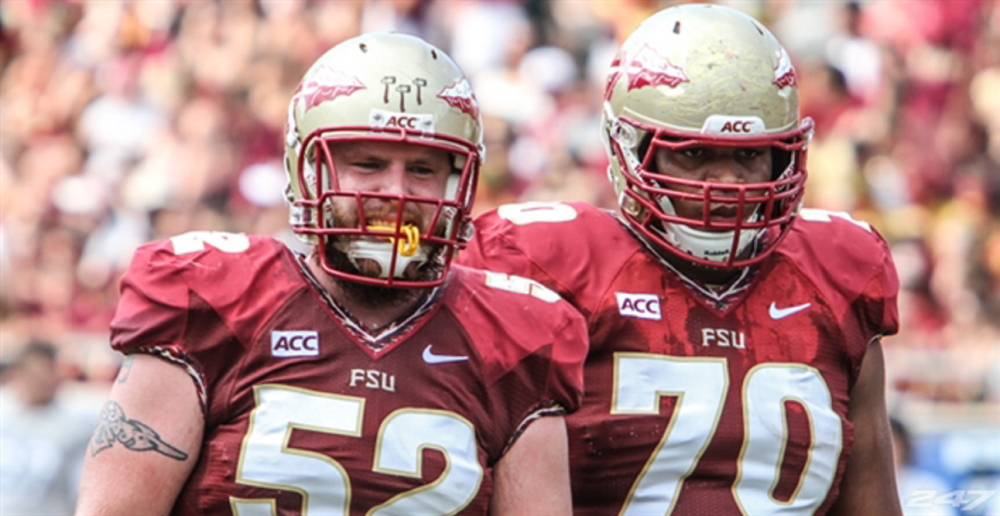 Center Bryan Stork, left, was picked by the Patriots Saturday in the fourth round of the NFL draft.