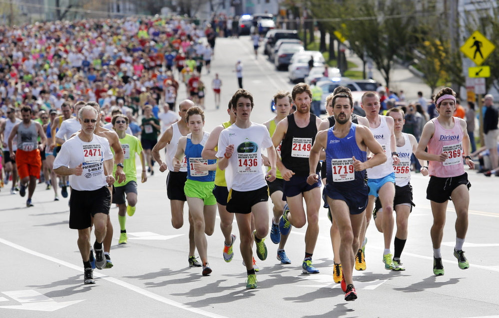 A two-time runner-up, Rob Gomez leads the pack early and maintains the advantage over a field of more than 2,400 finishers during the Portland Sea Dogs Mother's Day 5K.