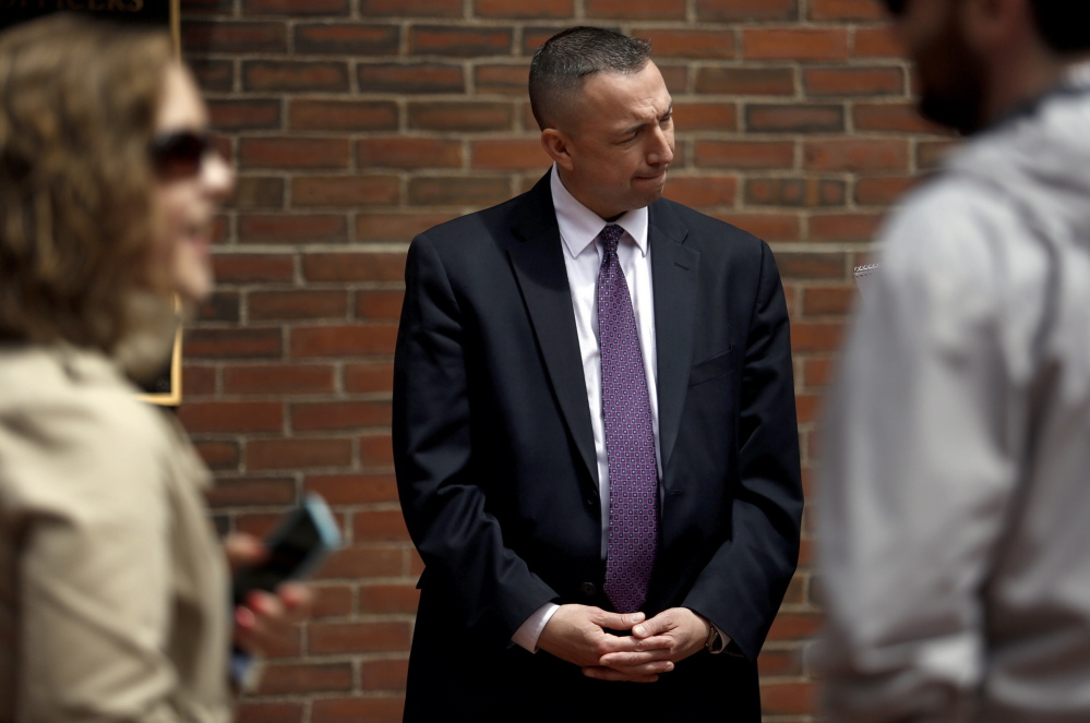 """Portland Police Chief Michael Sauschuck talks with a reporter Tuesday after a news conference. Officials sought to reinforce residents' sense of security after a report said three violent gangs operate in the city. """"I take umbrage with the characterization. ... That is not the case in any way,"""" he said."""