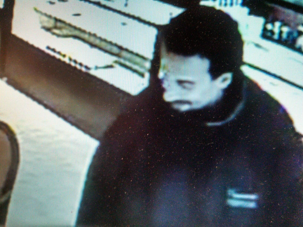 JEWELRY STORE THEFT: Surveillance images show the man who walked out of L Tardiff Jeweler in Waterville with two rings on his fingers in April. Police believe him to be Kevin Barr, 34, of 8 Broad St., who was charged with felony theft this week.