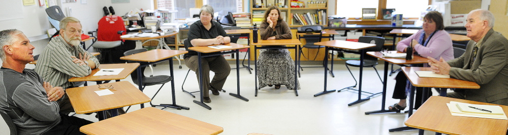 IMPORTANT VISIT: Education Commissioner Jim Rier, right, speaks with faculty and administrators Wednesday at Cony.