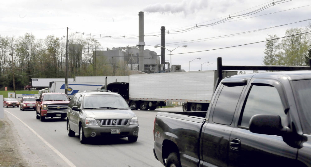 shift change: Workers at the Sappi paper mill in Skowhegan exit the mill on Wednesday. The parent company has announced a 5 percent reduction in its nationwide workforce, also affecting the Skowhegan operation.