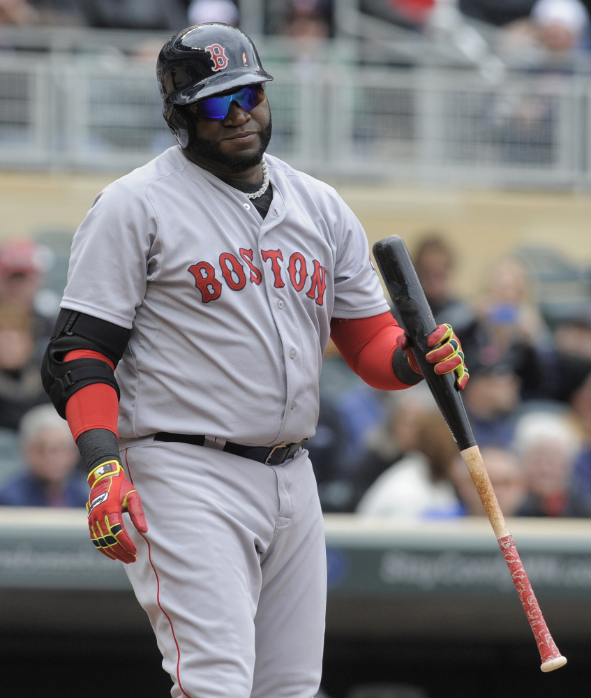 Red Sox designated hitter David Ortiz reacts after being struck out by Twins pitcher Phil Hughes in the fourth inning Thursday.