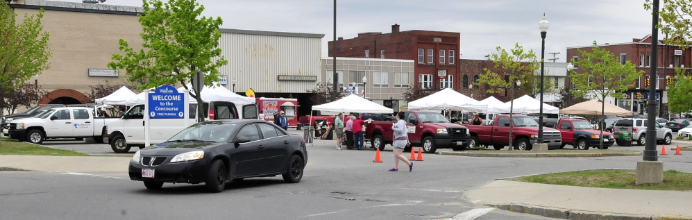 FOOD FOR THOUGHT: Vendors set up every Thursday in The Concourse for the Downtown Waterville Farmers' Market.