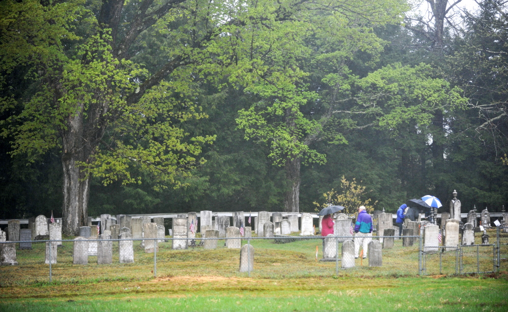 'An open-air museum': Members of the Maine Old Cemetery Association walk through Frederic Cemetery in Starks on Saturday. Starks hosted the group's annual spring meeting.