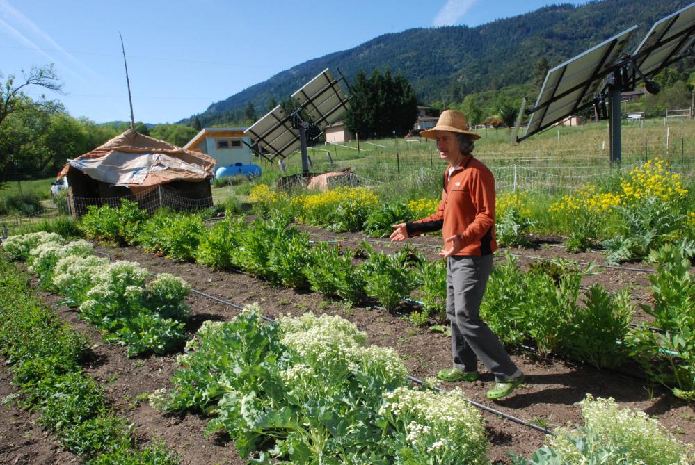 Chuck Burr explains his organic seed growing techniques on his farm outside Ashland, Ore.