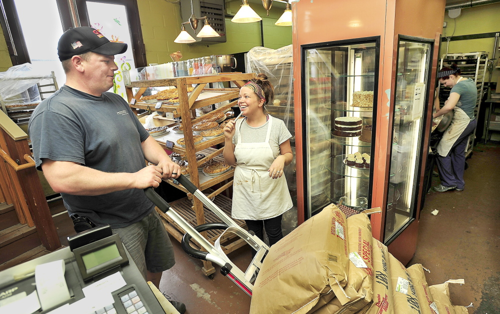 Manager Emily Joy talks with Tim Hopkins of Gordon Food Services as he delivers supplies to Two Fat Cats Bakery, which makes pastries daily for the Nova Star.