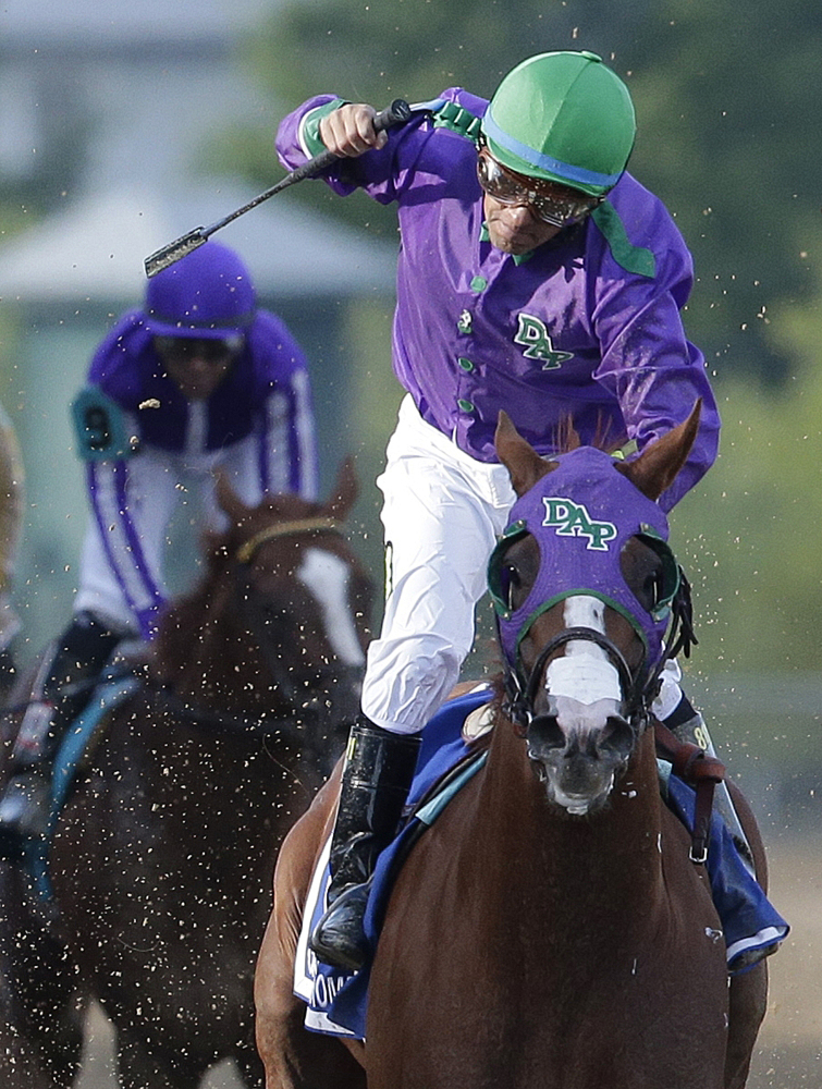 HOPING TO GO: Jockey Victor Espinoza celebrates aboard California Chrome after winning the 139th Preakness Stakes on Saturday at Pimlico Race Course in Baltimore. California Chrome might abandon his Triple Crown bid if New York officials do not allow the colt to wear a nasal strip in the Belmont Stakes.