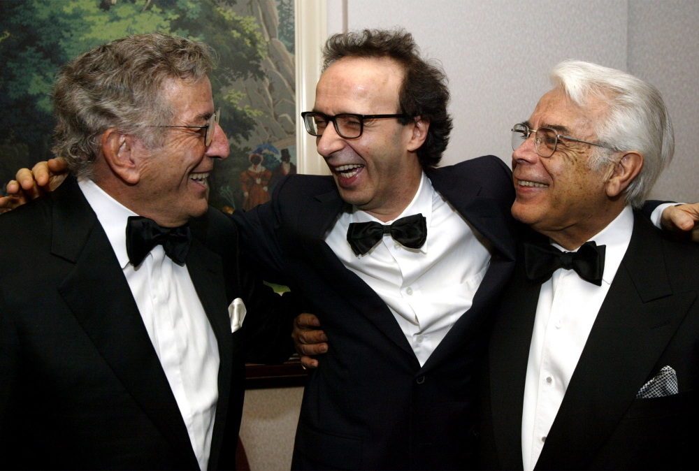 Singer Jerry Vale, right, is shown with singer Tony Bennett, left, and director Roberto Benigni. Vale has died at age 83.