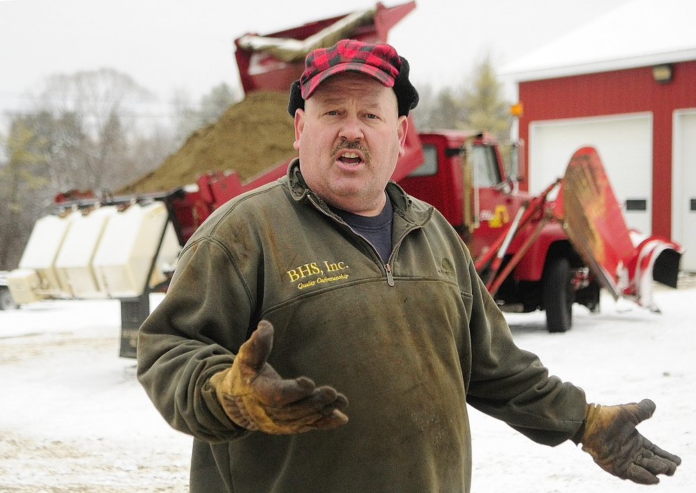 FARMINGDALE CONTRACTING: Chris Ellis talks about the calcium chloride dispensers on his plow trucks in December at Ellis Construction in Farmingdale.
