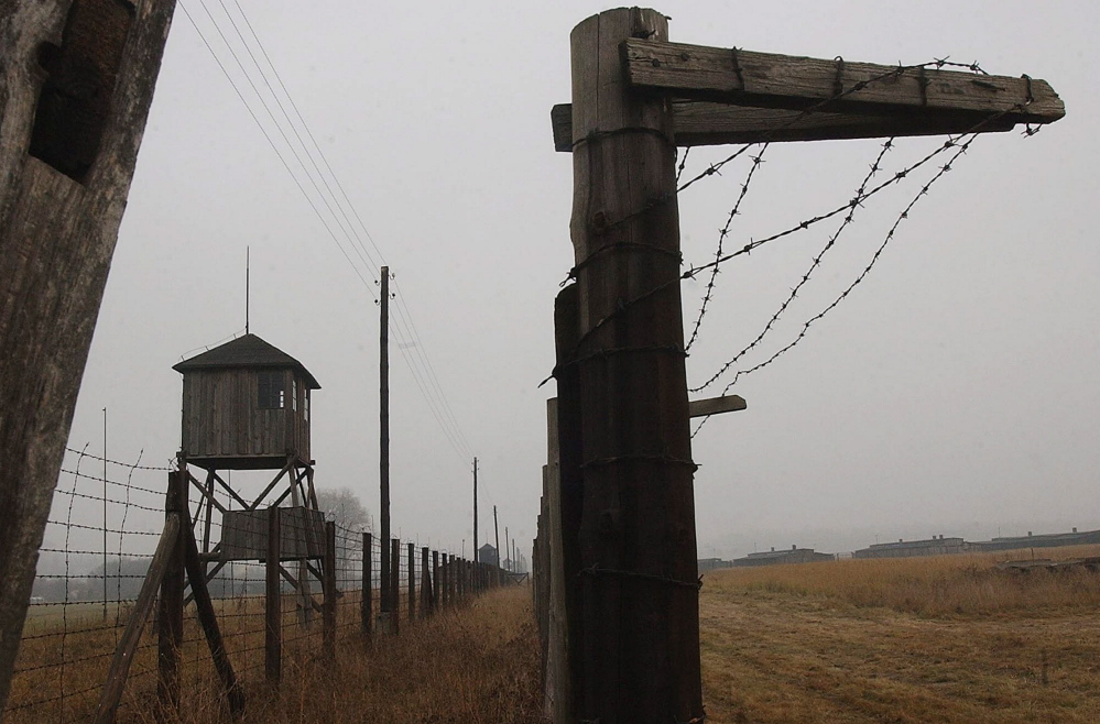 In this November 2005 file picture watch towers and a barbed wire fence of the former Nazi death camp Majdanek outside the city of Lublin in eastern Poland. The head of Germany's special prosecutors' office that investigates Nazi war crimes says the first phase of a probe of hundreds of former Majdanek death camp guards is nearly complete. Federal prosecutor Kurt Schrimm told reporters Tuesday May 20, 2014 his office was preparing to recommend within the next two weeks that state prosecutors pursue charges against multiple suspects.