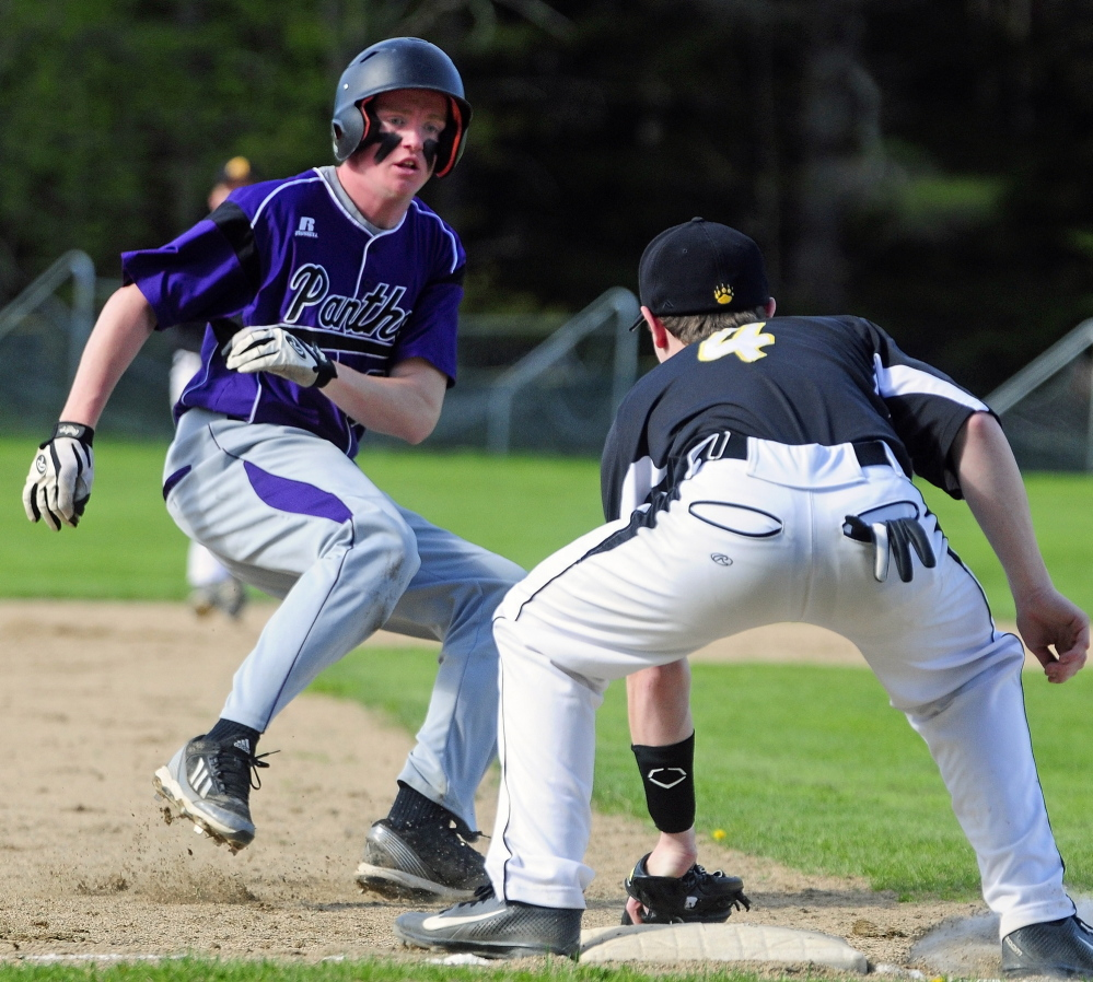 AVOIDING THE TAG: Waterville baserunner Kaleb Kane, left, puts on the brakes and tries to reverse direction when he sees that Marancook third baseman Max McQuillen already has ball in his glove during a game Wednesday in Readfield.