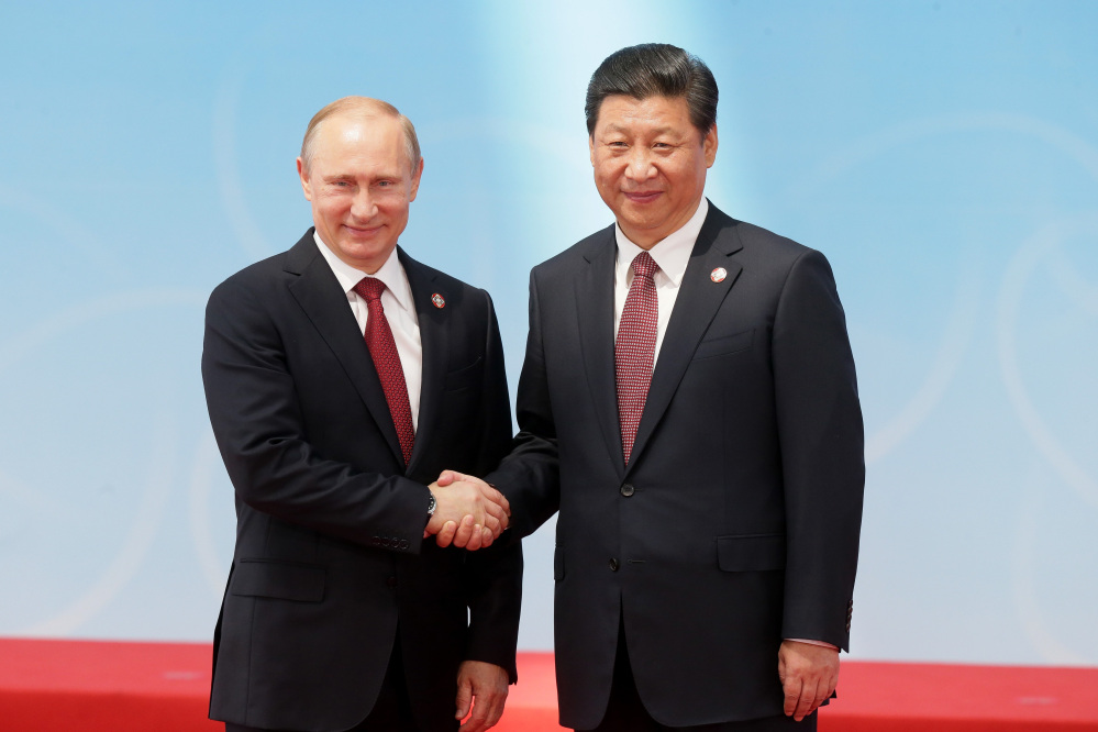 Russia's President Vladimir Putin and China's President Xi Jinping pose for a photo during the fourth Conference on Interaction and Confidence Building Measures in Asia, in Shanghai, China, on Wednesday.
