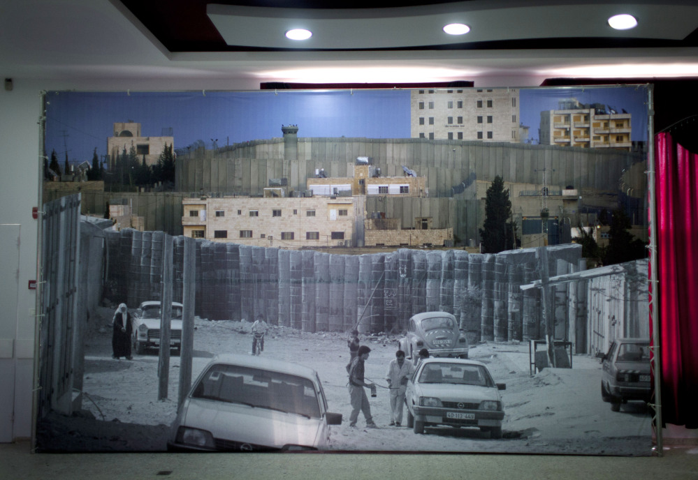 A big poster decorates the main hall in the Dheisheh Palestinian refugee camp that will receive Pope Francis during his scheduled 30-minute visit to the West Bank city of Bethlehem this weekend. Camp residents hope even that brief visit will shine a light on what they say is their forgotten plight. Some 190,000 of the West Bank's 2.4 million Palestinians live in refugee camps.