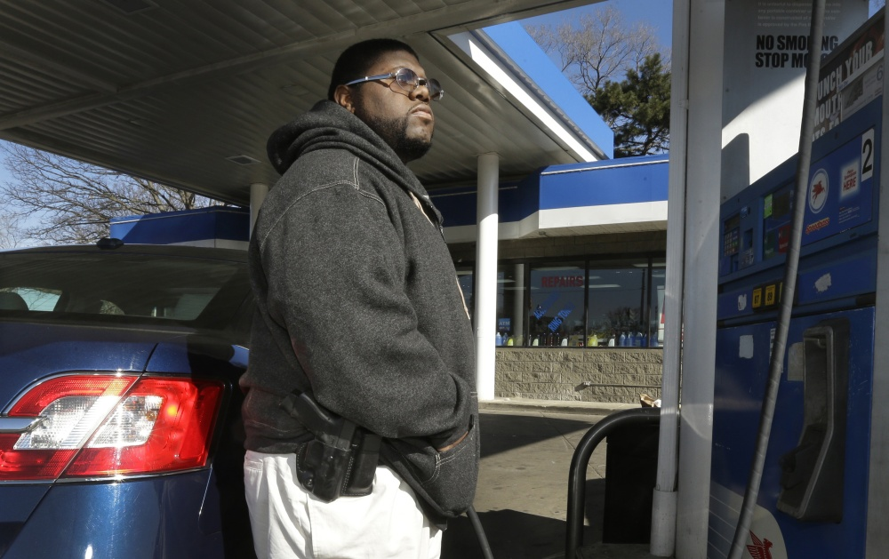 To avoid becoming a carjacking victim, Greg Champion wears a gun on his hip whenever he's pumping gas. Through May 19, Detroit has recorded 191 carjackings this year.
