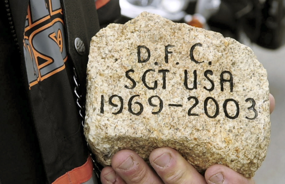 RECALLING A SOLDIER: David Boyd talks about Army Sgt. Daniel Cunningham's stone during a stopover by The Summit Project convoy on Friday at the West Gardiner rest area off the Maine Turnpike.