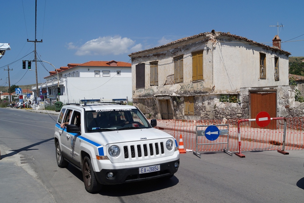Police patrol an old building that was damaged after a magnitude 6.3 earthquake on the northeastern Aegean Sea island of Lemnos, Greece, on Saturday.