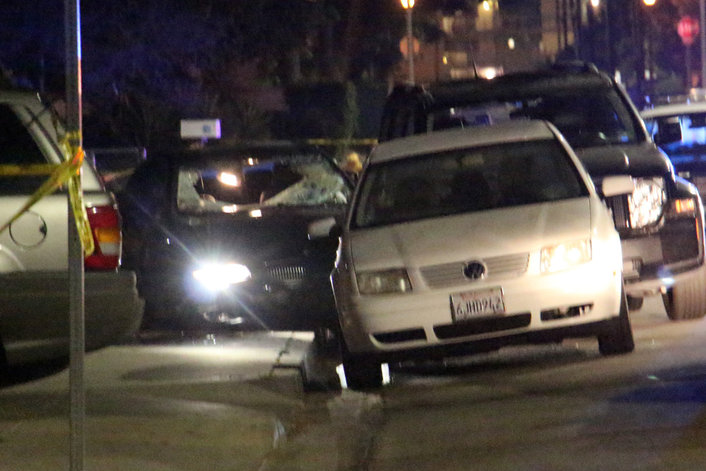 """In this image provided by KEYT-TV, a car window is shot out after a mass shooting near the campus of the University of Santa Barbara in Isla Vista, Calif., late Friday night. A drive-by shooter went on a """"mass murder"""" rampage near the Santa Barbara university campus that left seven people dead, including the attacker, and seven others wounded, authorities said Saturday."""