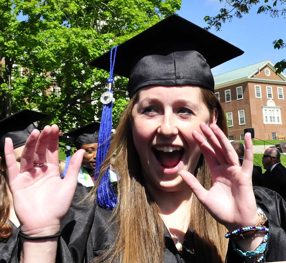 YEAH: Colby College graduate Amelia Barnett calls out to family members during the procession for the 193rd commencement exercise at the Waterville college on Sunday.
