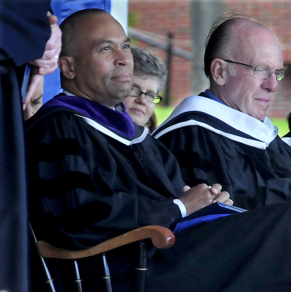 HONOR: Massachusetts Gov. Deval Patrick, left, listens as honorary degrees are conferred on recipients during the 193rd commencement at Colby College in Waterville on Sunday. Patrick gave the commencement address and received an honorary Doctor of Laws degree. Fellow degree recipient William Chace is at right.