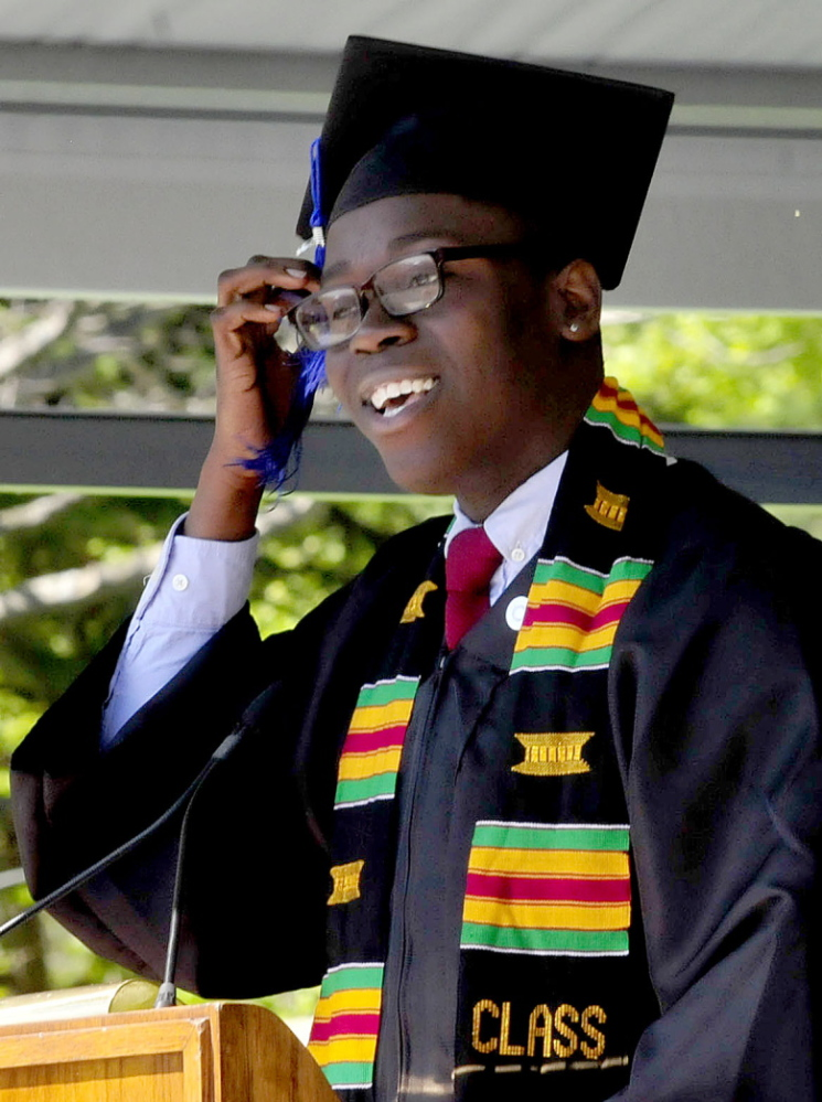 THANKS FOR THE MEMORIES: Colby College Senior Class Speaker Omari Matthew brushes the tassel from his face while speaking personally to the graduating class during the 193rd commencement at the Waterville college on Sunday.