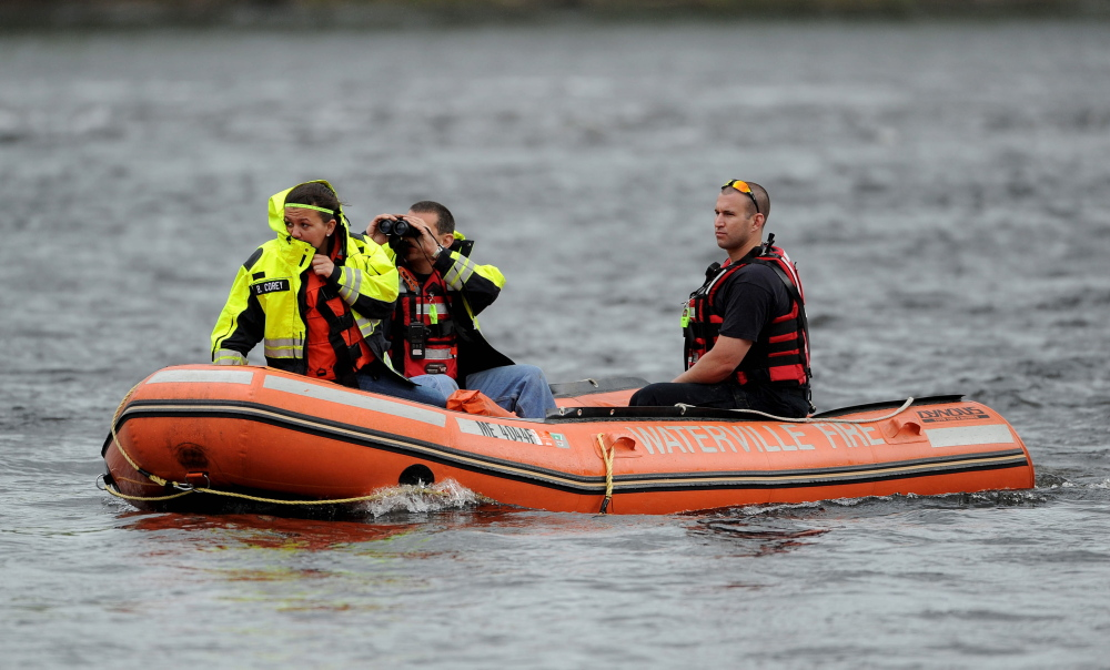 Staff photo by Michael G. Seamans A search crew from the Waterville fire department search the Kennebec River near the Hathaway Center for a reported person in the water on Saturday, May 24, 2014.