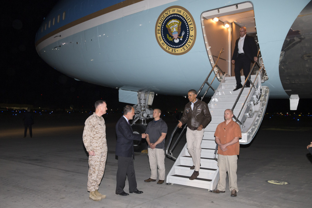 U.S. Ambassador to Afghanistan James Cunningham, second from left, and Marine Gen. Joseph Dunford, commander of the U.S.-led International Security Assistance Force, left, greet President Obama as he steps off Air Force One at Bagram Air Field on Sunday.