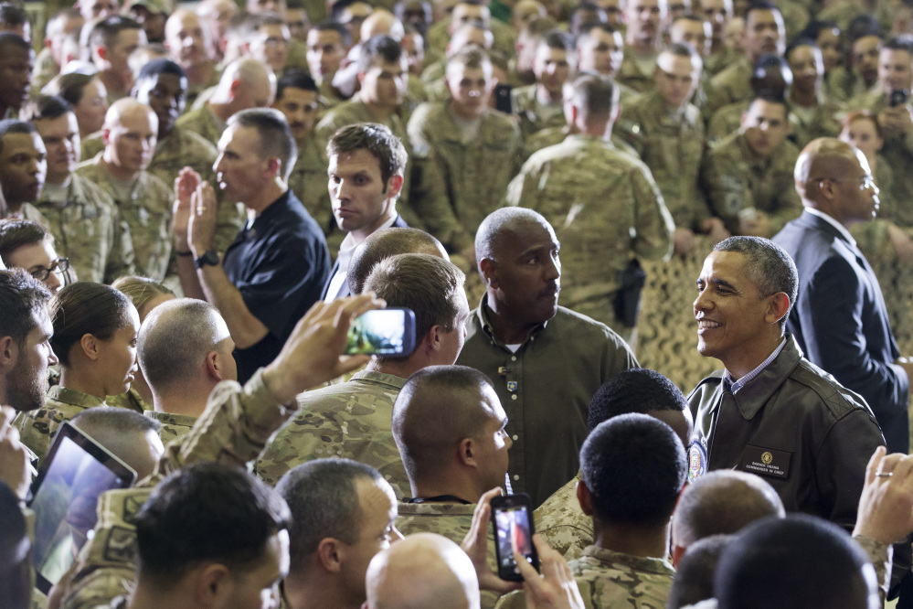 President Obama greets troops at Bagram Air Field, north of Kabul, Afghanistan, during an unannounced visit on Sunday.