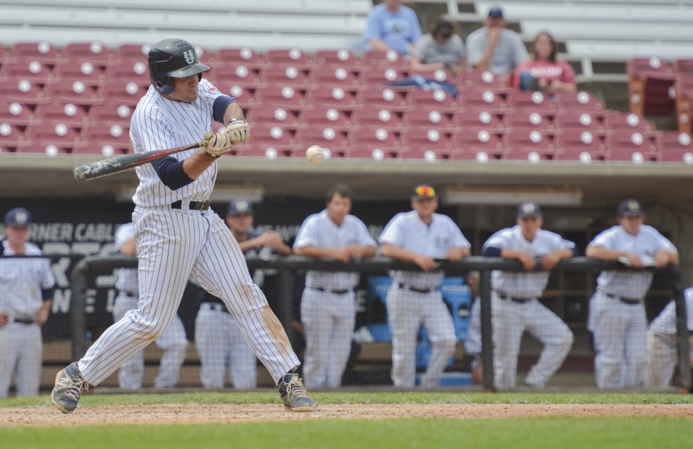 USM's Chris Bernard hits a run scoring single in the eighth inning of the Huskies' 15-3 loss to Emory on Monday.