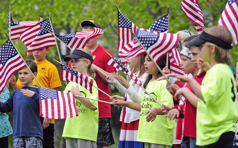 "Wayne Elementary School students sing ""You're A Grand Old Flag"" during Memorial Day events in Wayne Monday."