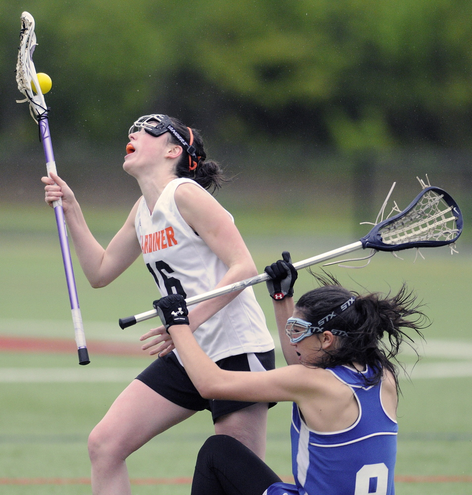 WATERVILLE, ME - MAY 27: Gardiner Area High School's Bryce Smith, left, collides with Morse High School's Maddy Olsen Tuesday May 27, 2014 during a lacrosse match up in Waterville. (Photo by Andy Molloy/Staff Photographer)