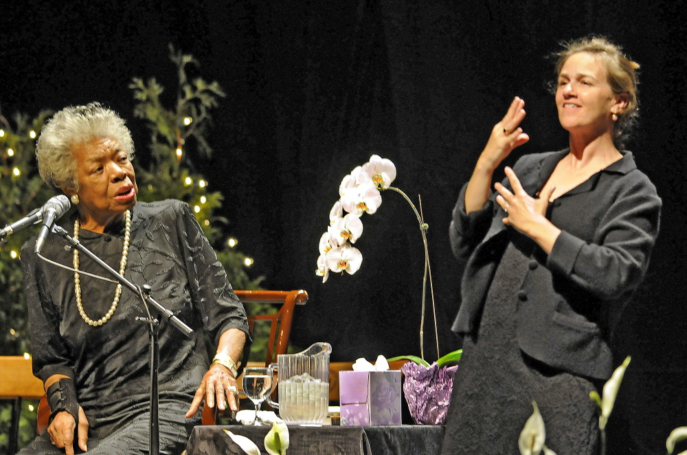 ANGELOU VISIT: Maya Angelou, left, greets greets the crowd at the Augusta Civic Center with a song April 26, 2010. At right is sign language interpreter Margaret Haberman.