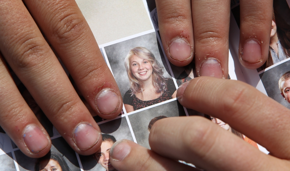 "Wasatch sophomore Rachel Russell, 16, points to her altered school yearbook photo. ""I was pretty angry about it, really, because that's who we are,"" said Russell, who had sleeves added to her picture."