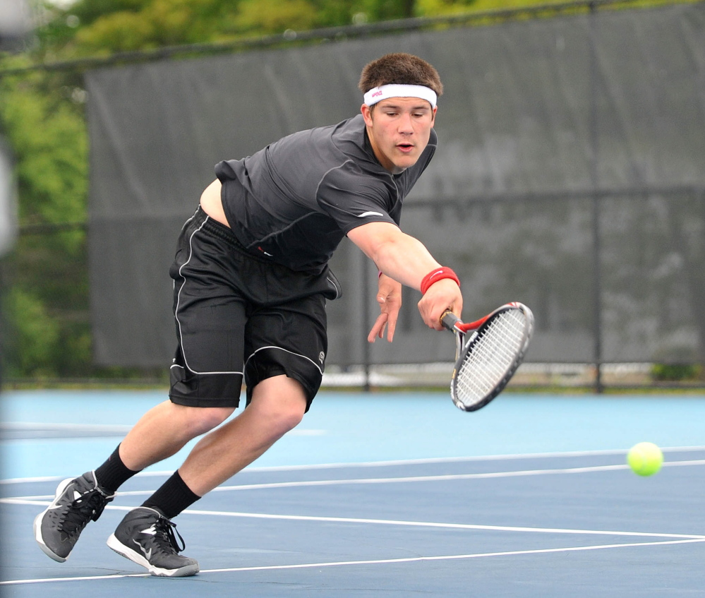 Dive: Monmouth Academy's Kasey Smith tries to returns a shot from Waterville Senior High School's Zack Disch at the Round of 48 singles tournament hosted by Colby College in Waterville on Saturday. Disch defeated Smith, 3-6, 6-3, 6-3.