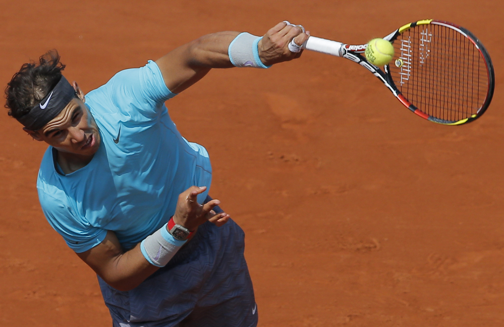 Spain's Rafael Nadal serves to Argentina's Leonardo Mayer during their third-round match of the French Open on Saturday in Paris. Nadal advanced with a 6-2, 7-5, 6-2 win.
