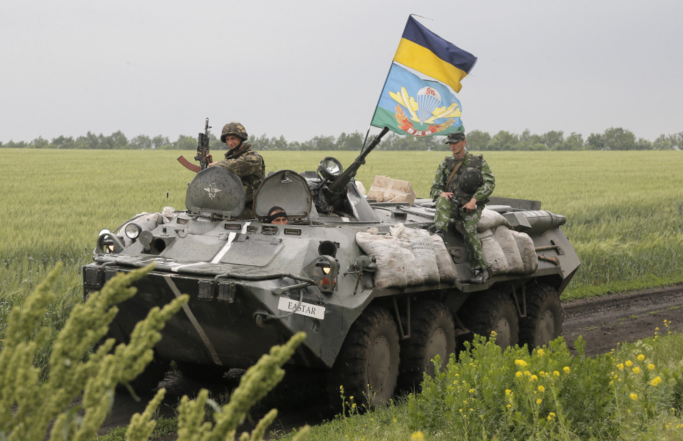 Ukrainian army paratroopers move to position in Slovyansk, Ukraine, on Saturday. The Ukrainian Acting Defense Minister said on Friday that troops had ousted separatists from southern and western parts of the Donetsk region and north of the Luhansk region.