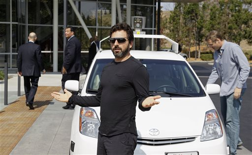 Google co-founder Sergey Brin talks about riding in a driverless car in this 2012 photo.