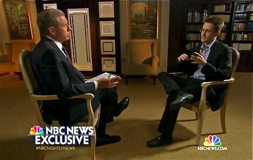 In this image taken from video provided by NBC News, Edward Snowden, a former National Security Agency contractor, right, speaks to NBC News anchor Brian Williams.